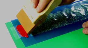 Use a Squeegee to Drag Paint Across Stencil
